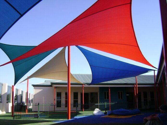 На фото: Дизайн-решение навеса для игровой площадки VERANDA Теневые паруса verandarussia